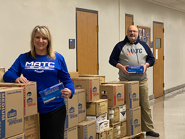 MATC's Healthcare Pathway Dean Dr. Kelly J. Dries and Operations Director Dr. Eric Gass with donations of personal protective equipment (PPE) donated by the college.